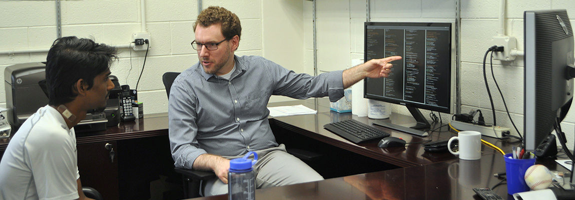 Dr. Graeme Kennedy advising a student in his office